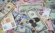 A collection of various foreign currencies from countries spanning the globe. Many different currencies as colorful background concept global money